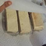 bbq tofu getting pressed